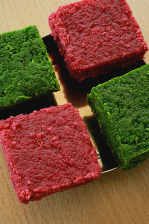 A dish of red and green burfi Stock Photo