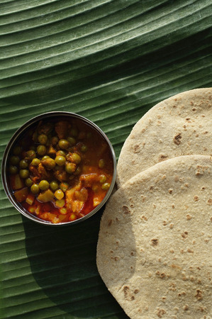 vegetable curry: Still life of chapati and mixed vegetable curry on a banana leaf