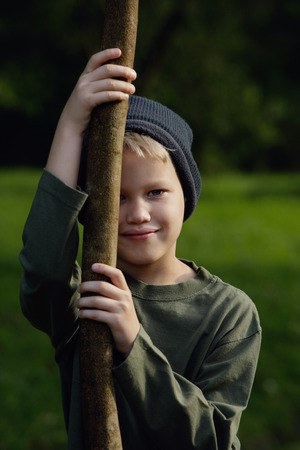 young boy with big stick
