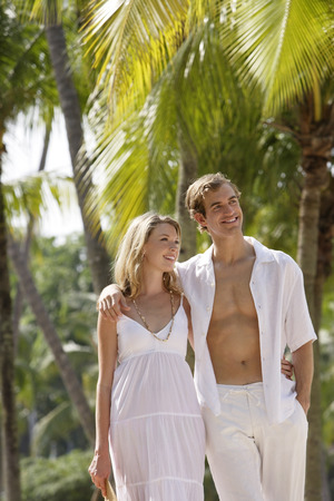 couple walking in tropics