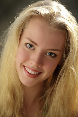 Head shot of smiling young, blonde woman Stock Photo
