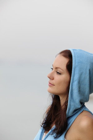 woman profile: profile of young woman wearing hooded sweatshirt LANG_EVOIMAGES