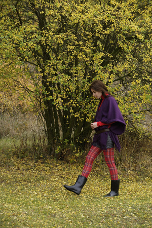 Young woman wandering through grove
