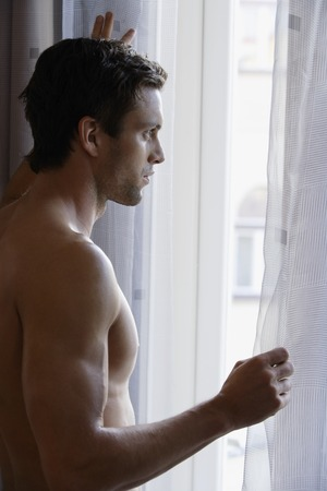 think through: Profile of man looking out window
