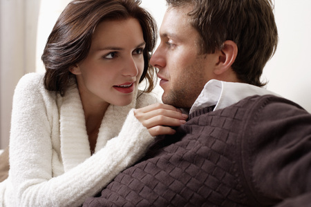 cropped shot of young couple looking at each other Stock Photo