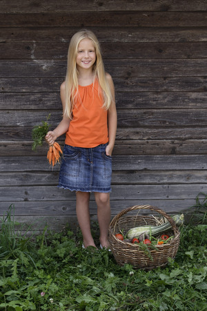 girl holding bunch of carrots