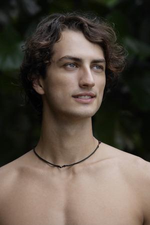Young man wearing no shirt Imagens - 69402430