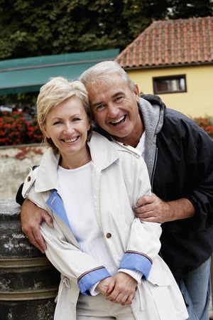 portrait of mature couple hugging and smiling