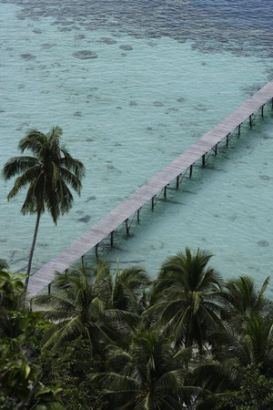 Pier in ocean from tropical island Stock Photo