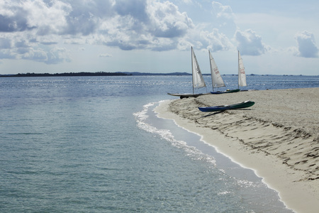 sail boats moored on sandy beach Stock Photo - 77280348