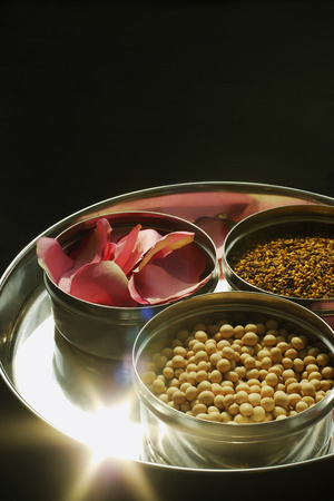Silver platter of natural beauty items, and rose petals Stock Photo