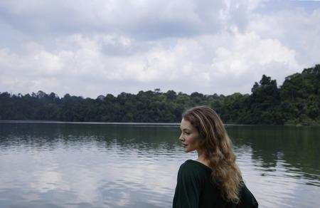 woman profile: Profile of woman standing near lake