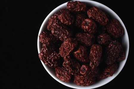Bowl of medicinal red dates used for Chinese medicine Stock Photo - 77280361
