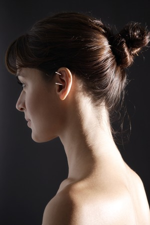 ear acupuncture: acupuncture needles in womans ear