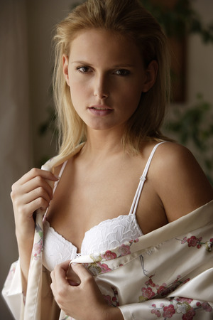 silk bra: Young woman in bra and silk robe LANG_EVOIMAGES