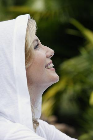 woman profile: Profile of woman in white hooded sweatshirt