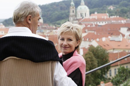 european ethnicity: mature man looking at view while mature woman looks at camera