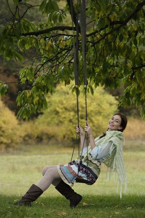 Young woman in tree swing Banco de Imagens