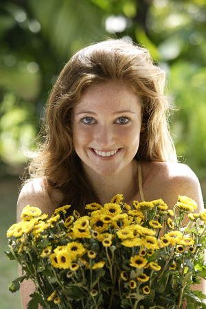 Young woman holding big bunch of daisies Stock Photo