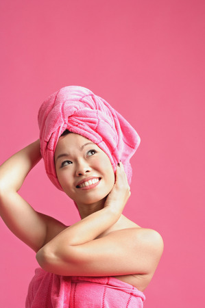 hair wrapped up: Woman wearing pink turban, looking away