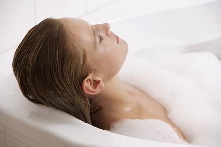 woman profile: Profile of woman reclining in bath tub