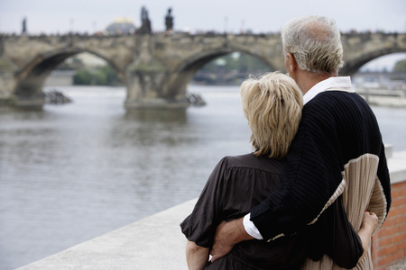 european ethnicity: rear view of mature couple looking at bridge LANG_EVOIMAGES