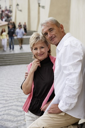 european ethnicity: mature couple standing on street smiling