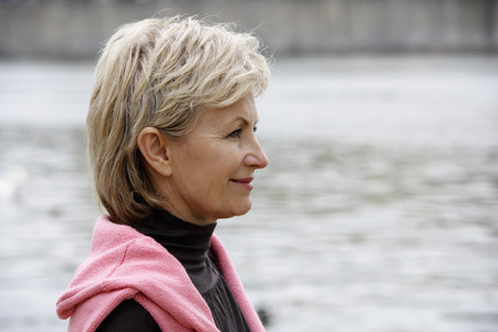 european ethnicity: profile of mature woman looking at river