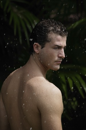 man having outdoor shower