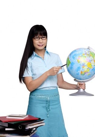 Woman holding globe and pointing at it