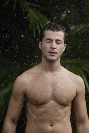 man having outdoor shower