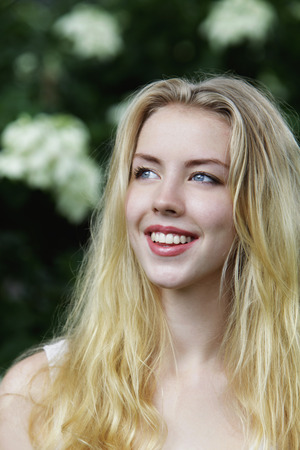 head shot of young woman with blonde hair smiling Banco de Imagens