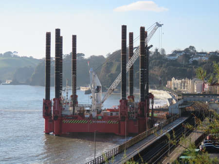 DAWLISH, DEVON, UK - Wavewalker 1 platform at Dawlish to upgrade the existing sea wall