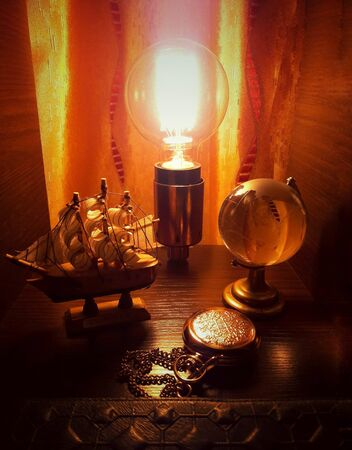 Edison lamp, globe, ship
