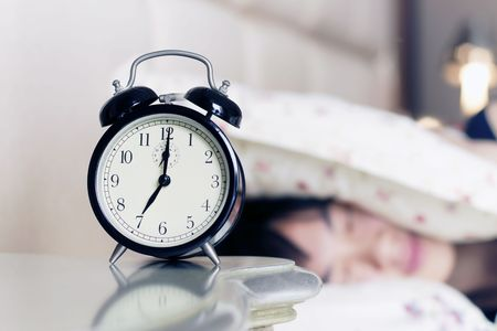 woman night: Waked Up by the Noise of Alarm Clock