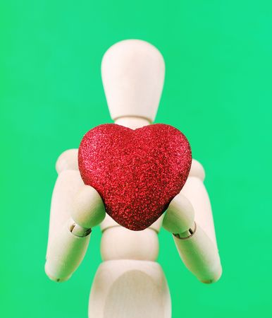 Wooden Person Give You His Heart Stock Photo - 4884203