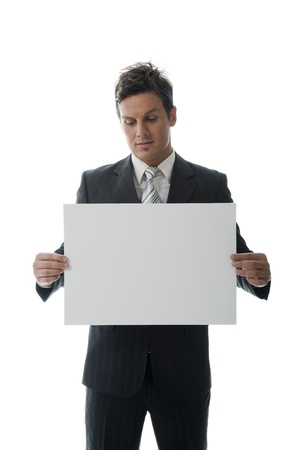 Well-dressed businessman holding an empty paper. photo