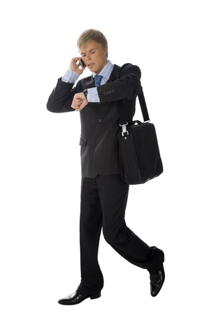 Businessman is walking and talking at the phone  photo