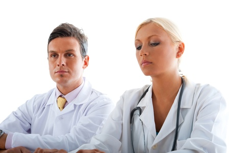 Two professional doctors checking results from computer screen. Stock Photo - 18649587