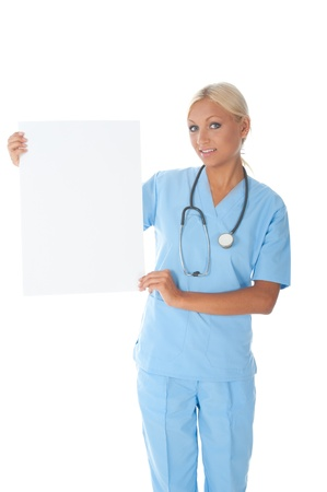 Nurse is holding an empty paper to write a message. photo