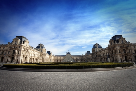 Square of Louvre Museum in Paris, France in a sunny winter day  photo