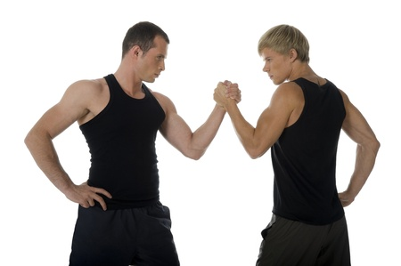 Two male armwrestlers trying to defeat each other. photo