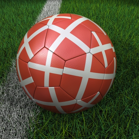 3D soccer ball with Denmark flag on green field. photo