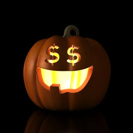 Halloween pumpkin is glad to see US Dollars. photo