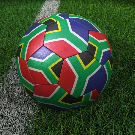 3D soccer ball with South Africa flag on green field. photo