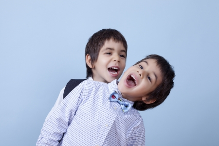 Funny twins are enjoying together. photo