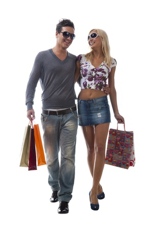 Happy young couple coming back from shopping  photo