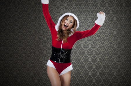 Mrs. Santa is jumping with joy. photo