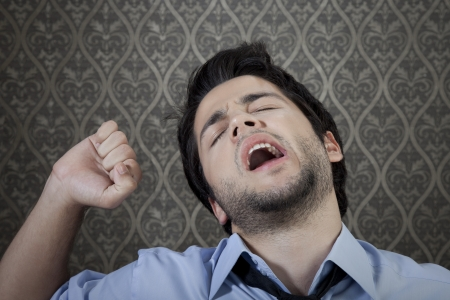 Young businessman needs a good sleep. Stock Photo - 23783523