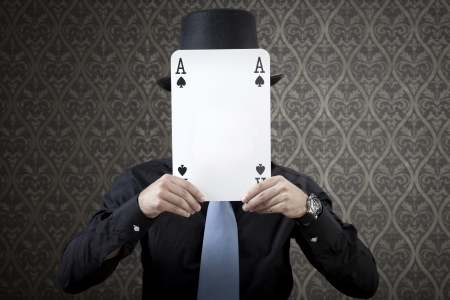 Businessman is trying to hide his poker face from his opponent. photo
